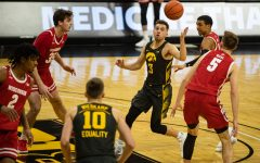 Iowa guard Jordan Bohannon controls the ball during a men's basketball game between Iowa and Wisconsin at Carver-Hawkeye Arena on Sunday, March 7, 2021. The Hawkeyes, celebrating senior day, defeated the Badgers, 77-73. (Shivansh Ahuja/The Daily Iowan)