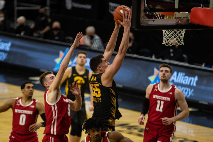 Iowa center Luka Garza leaps for a dunk during a men's basketball game between Iowa and Wisconsin at Carver-Hawkeye Arena on Sunday, March 7, 2021. The Hawkeyes, celebrating senior day, defeated the Badgers, 77-73.