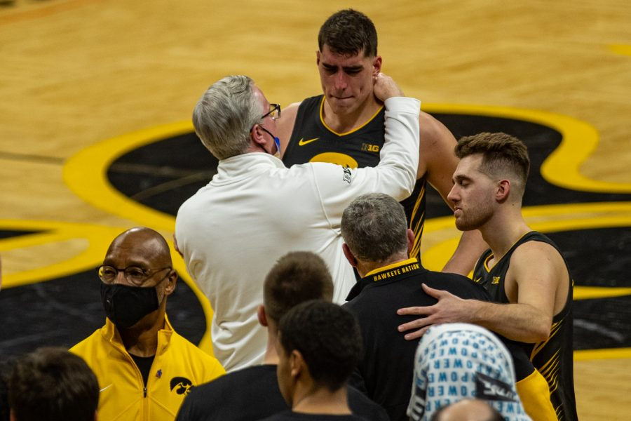 Iowa head coach Fran McCaffery congratulates Luka Garza after his final regular season game as a Hawkeye during a men's basketball game between Iowa and Wisconsin at Carver-Hawkeye Arena on Sunday, March 7, 2021. The Hawkeyes, celebrating senior day, defeated the Badgers, 77-73.