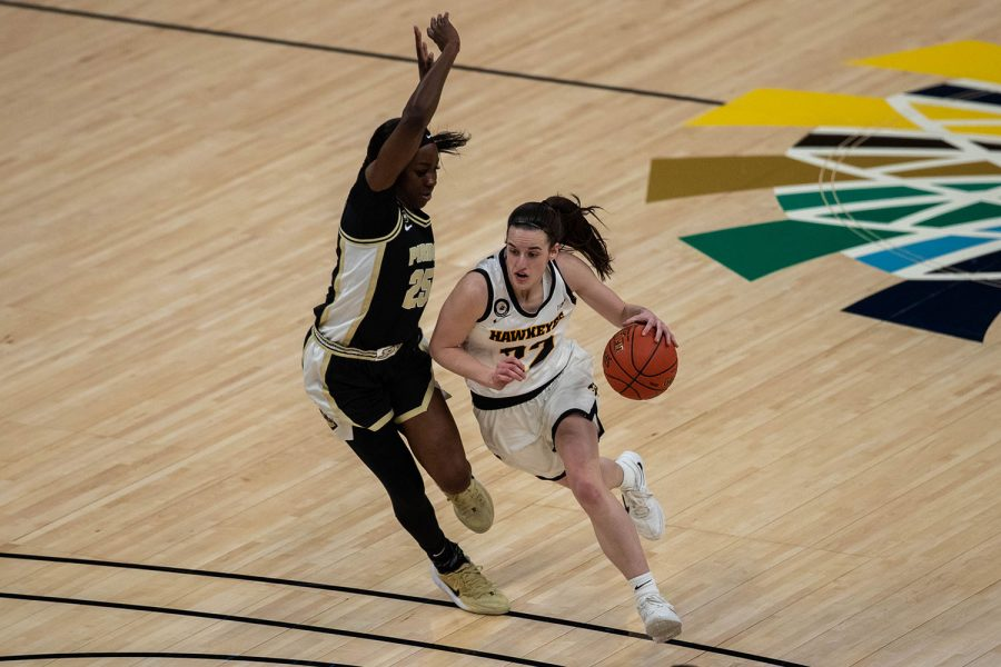 Iowa Guard Caitlin Clark (22) charges to the basket during a second round game of the Big 10 women's basketball tournament. Iowa, ranked #6, took on #11 Purdue in Indianapolis at the Bankers Life Fieldhouse Wednesday night. The Hawkeyes beat the Boilermakers, 83-72, advancing the Hawks to take on Rutgers Thursday night in the Big 10 quarterfinals.