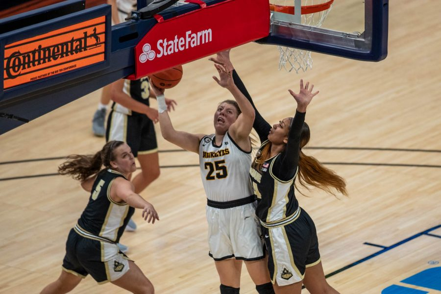 Iowa's Monkia Czinano (25) goes up for a shot during a second round game of the Big 10 women's basketball tournament. Iowa, ranked #6, took on #11 Purdue in Indianapolis at the Bankers Life Fieldhouse Wednesday night. (Kate Heston/The Daily Iowan)