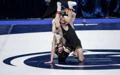 Iowa's Spencer Lee attempts a takedown against Purdue's Devin Schroder during the finals of the Big Ten Wrestling Tournament at the Bryce Jordan Center in State College, PA on Sunday, March 8, 2021. Lee won the match with a tech fall 21-3.