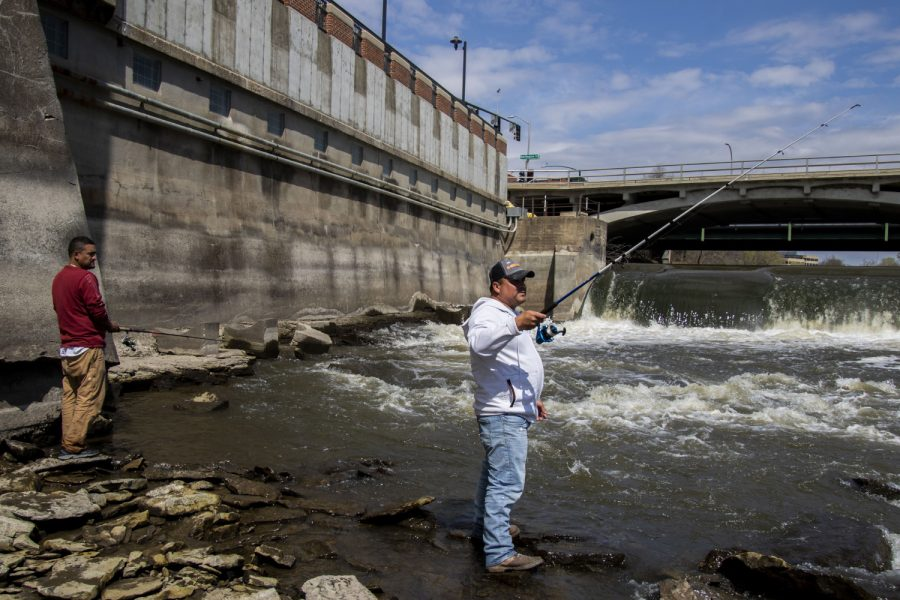 Carlos Flores (left) and Adam Escavar (right) spend their morning fishing on Sunday, April 18, 2021. The two were below the Burlington Street Dam.