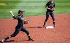 Iowa short stop Grace Banes throws out a runner during a softball game at Pearl Field on Saturday, April 3 during a softball game between Iowa and Indiana. The Hawkeyes defeated the Hoosiers 8-0 in five innings.