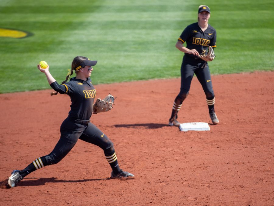 Iowa+short+stop+Grace+Banes+throws+out+a+runner+during+a+softball+game+at+Pearl+Field+on+Saturday%2C+April+3+during+a+softball+game+between+Iowa+and+Indiana.+The+Hawkeyes+defeated+the+Hoosiers+8-0+in+five+innings.