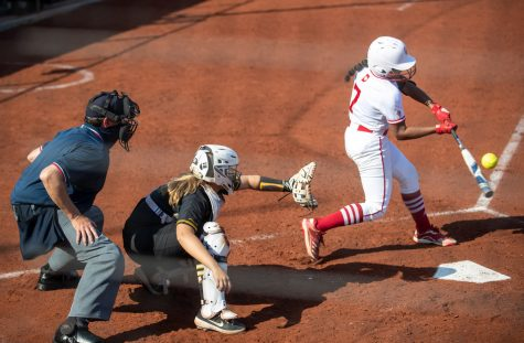 Indiana outfielder Aaliyah Andrews connects for a base hit during a softball game between Iowa and Indiana at Pearl Field on Saturday, April 3, 2021. The Hawkeyes defeated the Hoosiers 1-0.