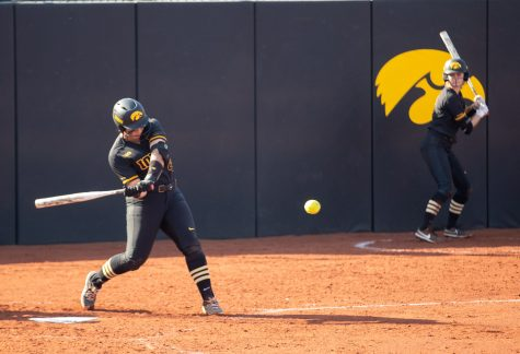 Iowa utility player Marissa Peek hits a home run during a softball game between Iowa and Indiana at Pearl Field on Saturday, April 3, 2021. Peek recorded the only run for the Hawkeyes but it proved enough. The Hawkeyes defeated the Hoosiers 1-0.