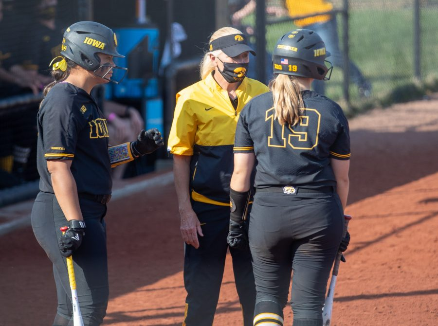 Iowa head coach Renee Gillispie talks with her players during a softball game between Iowa and Indiana at Pearl Field on Saturday, April 3, 2021. The Hawkeyes defeated the Hoosiers 1-0.