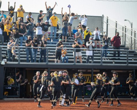 Iowa players and fans celebrate after a softball game between Iowa and Indiana at Pearl Field on Saturday, April 3, 2021. The Hawkeyes defeated the Hoosiers 1-0.