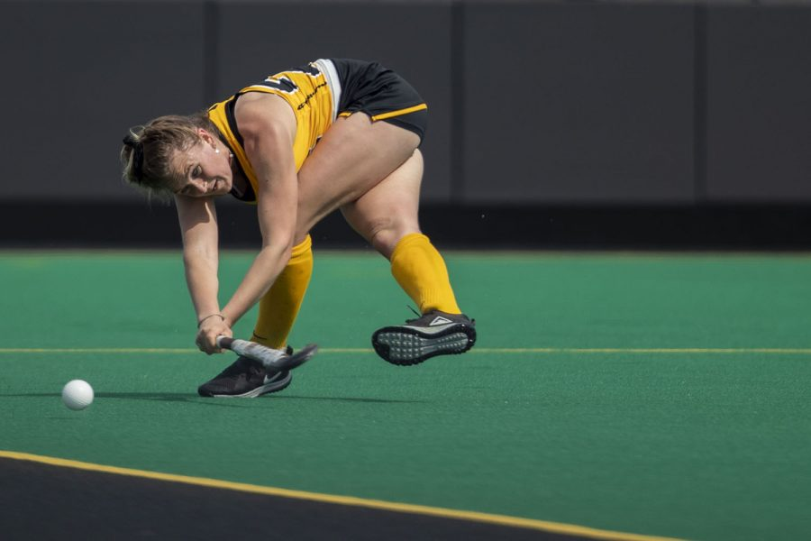 Iowa forward Maddy Murphy sweeps the ball during the first quarter of a field hockey game against Maryland on Sunday, April 4, 2021 at Grant Field. The Hawkeyes defeated the Terrapins, 3-0.