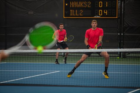 Iowa's Kareem Allaf (left) and Joe Tyler (right) prepare to receive the ball during a men's tennis meet between Iowa and  No. 14 Illinois on Friday, April 9 at the Hawkeye Tennis and Recreation Complex. The Fighting Illini defeated the Hawkeyes 5-2.