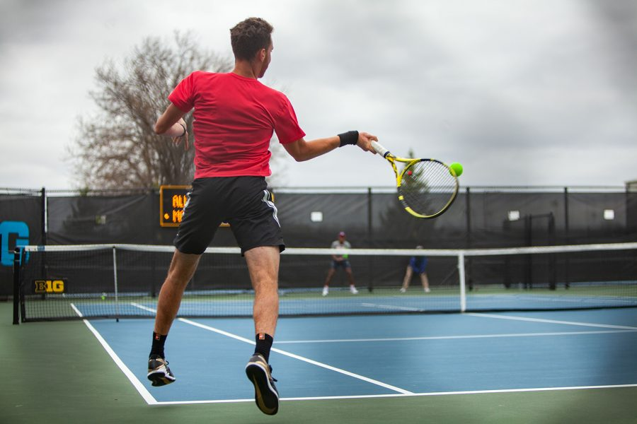 Iowa's Kareem Allaf prepares to return the ball during a men's tennis meet between Iowa and No. 14 Illinois on Friday, April 9 at the Hawkeye Tennis and Recreation Complex. The Fighting Illini defeated the Hawkeyes 5-2. (Ayrton Breckenridge/The Daily Iowan)