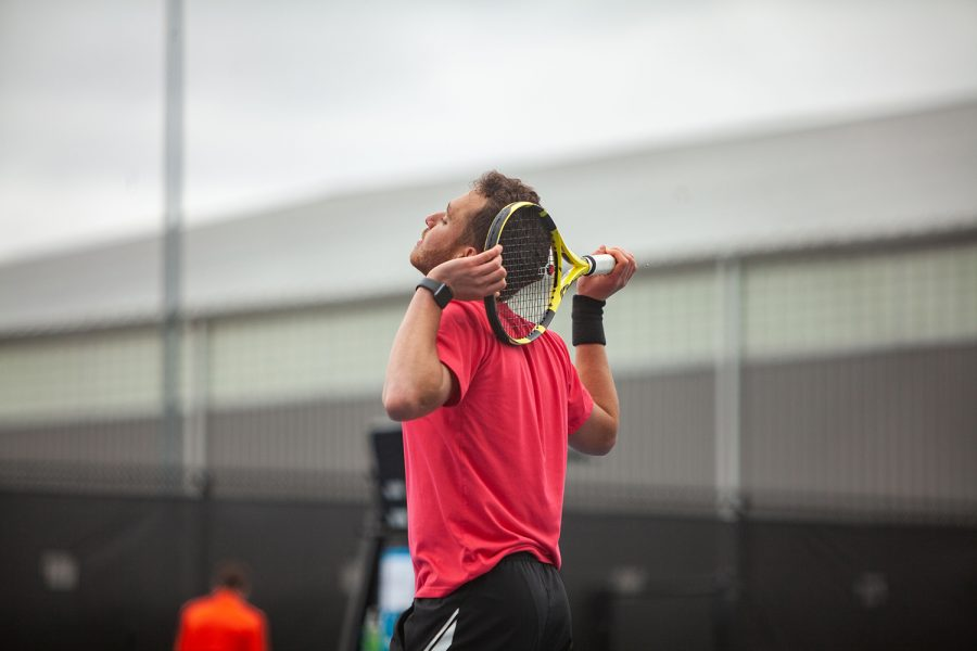 Iowa's Kareem Allaf rests his racket behind his head during a men's tennis meet between Iowa and No. 14 Illinois on Friday, April 9 at the Hawkeye Tennis and Recreation Complex. The Fighting Illini defeated the Hawkeyes 5-2.