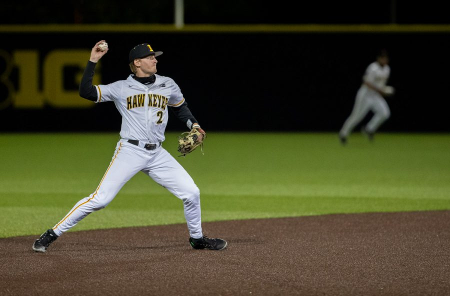 Iowa shortstop Brendan Sher throws the ball to first during a baseball game between Iowa and Minnesota at Duane Banks Field on April 9, 2021. The Hawkeyes defeated the Gophers 7-0.