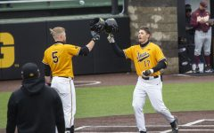 Iowa players, Dylan Nedved and Zeb Adreon, celebrate Nedved's home run during the Iowa baseball game v. Minnesota at the Duane Banks Field in Iowa City on April 11, 2021.