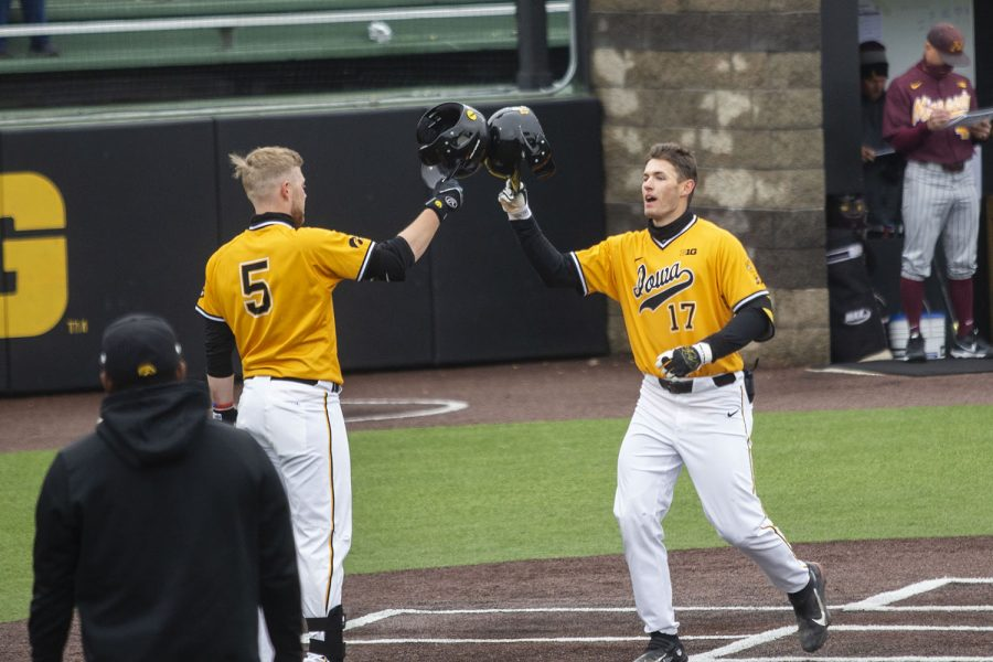 Iowa+players%2C+Dylan+Nedved+and+Zeb+Adreon%2C+celebrate+Nedved%E2%80%99s+home+run+during+the+Iowa+baseball+game+v.+Minnesota+at+the+Duane+Banks+Field+in+Iowa+City+on+April+11%2C+2021.+