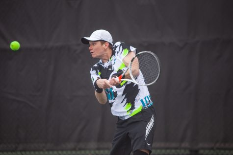 Iowa's Jason Kerst prepares to hit the ball during a men's tennis meet between Iowa and Northwestern on Sunday, April 11 at the Hawkeye Tennis and Recreation Complex. The Wildcats defeated the Hawkeyes 6-1.