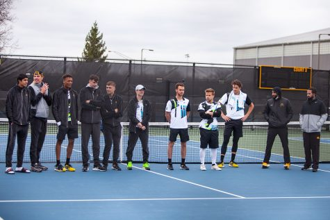 Iowa men's tennis team stands as the seniors are recognized after a men's tennis meet between Iowa and Northwestern on Sunday, April 11 at the Hawkeye Tennis and Recreation Complex. The Wildcats defeated the Hawkeyes 6-1. Iowa Athletics has cut men's tennis making this their last home meet in their final season.
