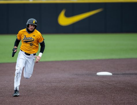 Iowa center fielder Ben Norman runs to third during a baseball game between Iowa and Minnesota at Duane Banks Field on Sunday, April 11, 2021. The Hawkeyes defeated the Gophers 18-0.
