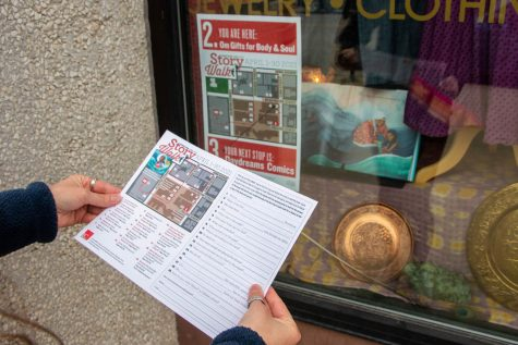 The Iowa City Public Library hosts a StoryWalk downtown Iowa City in which different pages of the book are displayed in different store fronts.