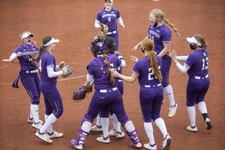 Northwestern teammates celebrate their win after the Iowa softball game v. Northwestern at Pearl Field on Friday, April 16, 2021. The Wildcats defeated the Hawkeyes with a score of 7-0.