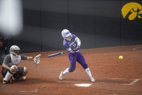 Northwestern infielder/outfielder, Rachel Lewis, hits the ball during the Iowa softball game v. Northwestern at Pearl Field on Friday, April 16, 2021. The Wildcats defeated the Hawkeyes with a score of 7-0.