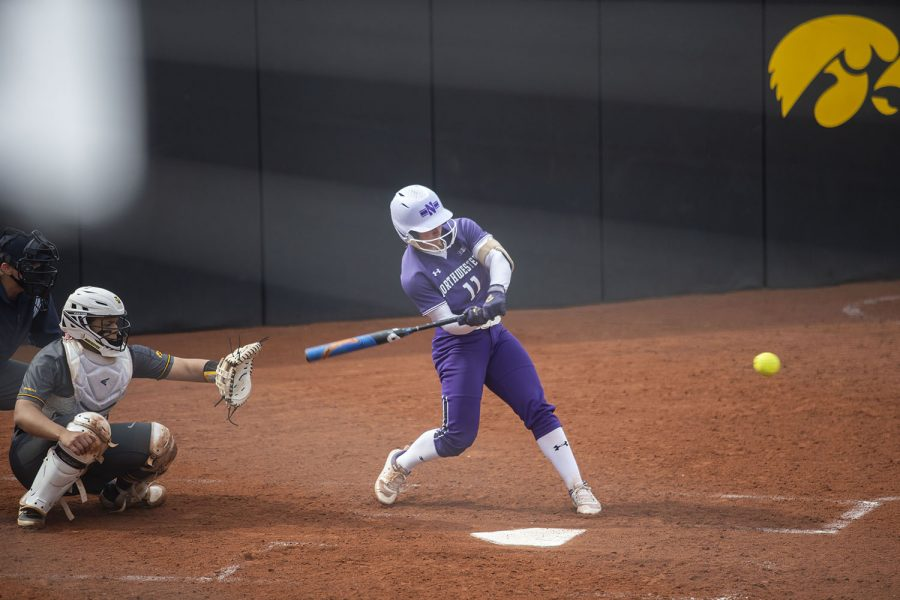 Northwestern+infielder%2Foutfielder%2C+Rachel+Lewis%2C+hits+the+ball+during+the+Iowa+softball+game+v.+Northwestern+at+Pearl+Field+on+Friday%2C+April+16%2C+2021.+The+Wildcats+defeated+the+Hawkeyes+with+a+score+of+7-0.+