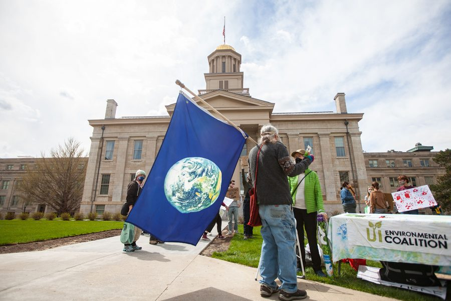 University of Iowa Environmental Coalition members and 100 Grannies members protest on the Pentacrest on Friday, April 16, 2021, over the use of pesticides. The groups listed all the pesticides used on campus along with their health and environmental effects.