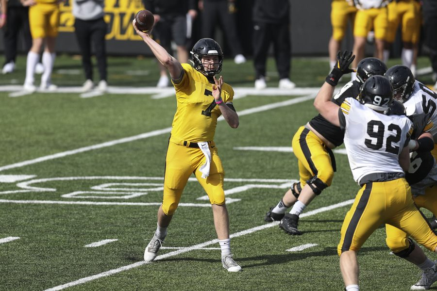 Iowa quarterback Spencer Petras (7) throws a pass during Iowa football spring practice on Saturday, April 17, 2021 in Kinnick Stadium.