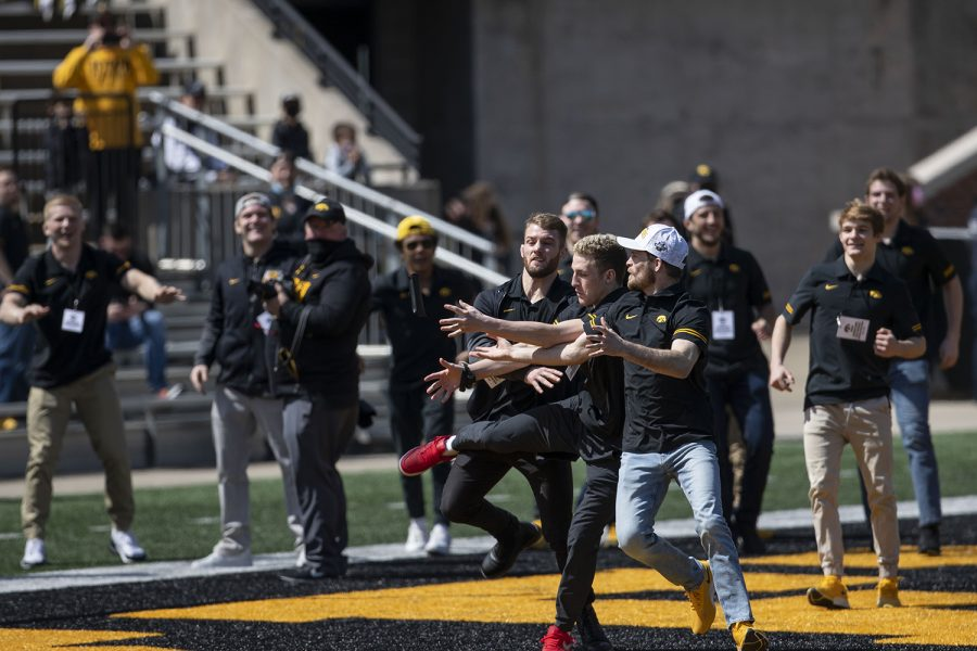 The Iowa wrestling team plays a game of football on the sidelines as Iowa football continues to practice during Iowa football spring practice on Saturday, April 17, 2021 in Kinnick Stadium.