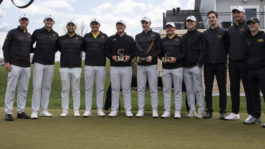 The Iowa men's golf team poses with their trophies after the third round of the Hawkeye Invitationals at Finkbine Golf Course on Sunday, April 18, 2021.