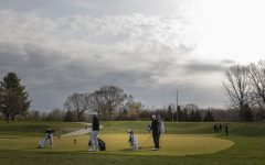 Iowa's Alex Schaake (left) gets ready to tee off during the third round of the Hawkeye Invitational at Finkbine Golf Course on Sunday, April 18, 2021. Iowa won the invitational with a final overall score of 840.