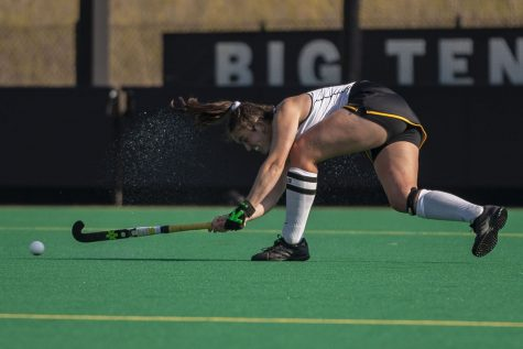 Iowa defender Anthe Nijziel sweeps the ball during the third quarter of the Big Ten field hockey tournament semifinals against No. 1 Michigan on Thursday, April 22, 2021 at Grant Field. The Hawkeyes were defeated by the Wolverines, 0-2. Michigan will go on to play against No. 7 Ohio State in the championships on Saturday.