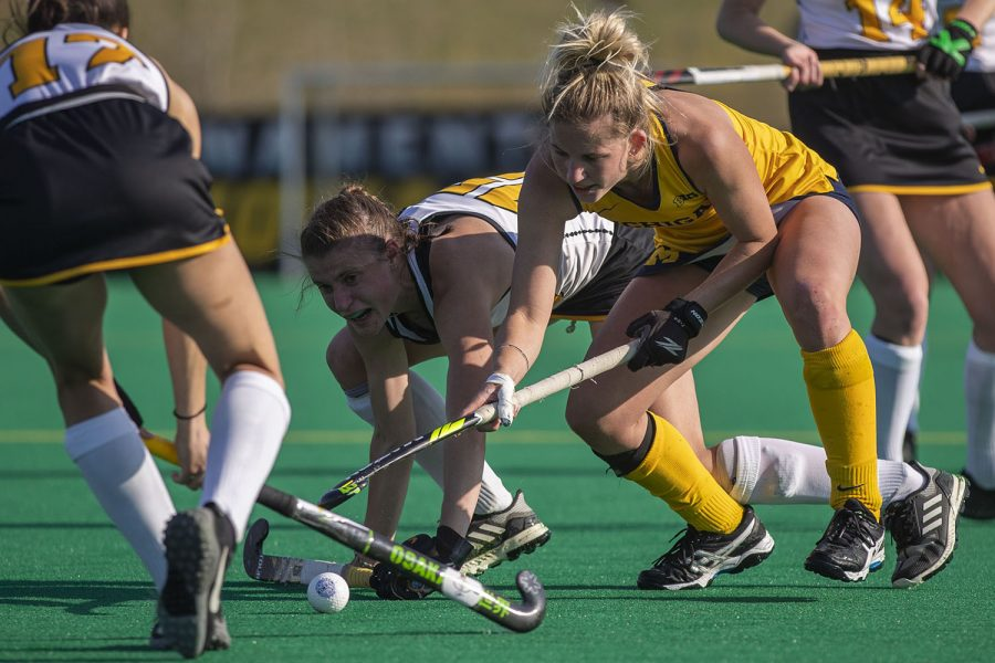 Iowa midfielder Esme Gibson fights for possession of the ball during the fourth quarter of the Big Ten field hockey tournament semifinals against No. 1 Michigan on Thursday, April 22, 2021 at Grant Field. With five minutes left of the game, Iowa pulled their goalkeeper to replace the position with another player on offense. The Hawkeyes were defeated by the Wolverines, 0-2. Michigan will go on to play against No. 7 Ohio State in the championships on Saturday.