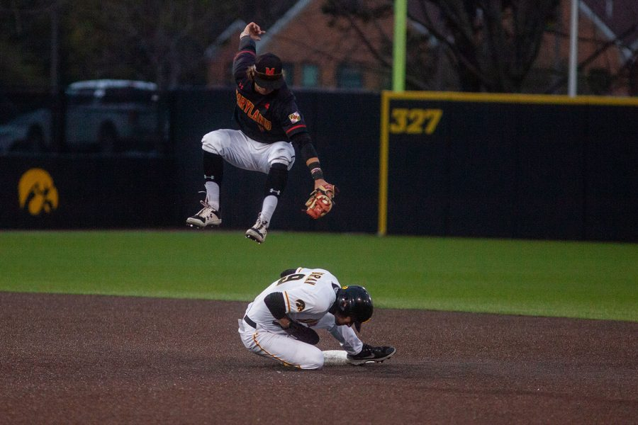 Iowa outfielder Ben Norman slides under Maryland infielder Benjamin Cowles' tag at second base during a baseball game between Iowa and Maryland on Friday, April 23, 2021 at Duane Banks Baseball Stadium. The Hawkeyes defeated the Terrapins 6-2.