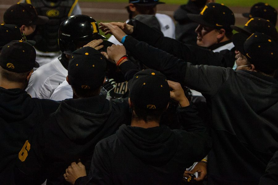 Iowa players congratulate Brayden Frazier after scoring during a baseball game between Iowa and Maryland on Friday, April 23, 2021 at Duane Banks Baseball Stadium. The Hawkeyes defeated the Terrapins 6-2.