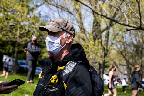 Coach Andrew Carter speaks with reporters at the end of Iowa rowing competition on Saturday, April 24, 2021.