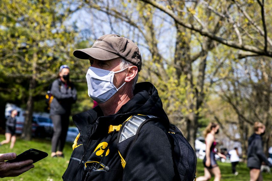 Coach+Andrew+Carter+speaks+with+reporters+at+the+end+of+Iowa+rowing+competition+on+Saturday%2C+April+24%2C+2021.