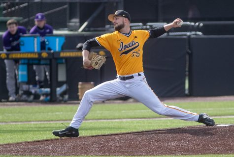 Iowa starting pitcher Cam Baumann throws a pitch during a baseball game between Iowa and Northwestern on Sunday, April 25, 2021 at Duane Banks Field. The Hawkeyes defeated the Wildcats 15-4.