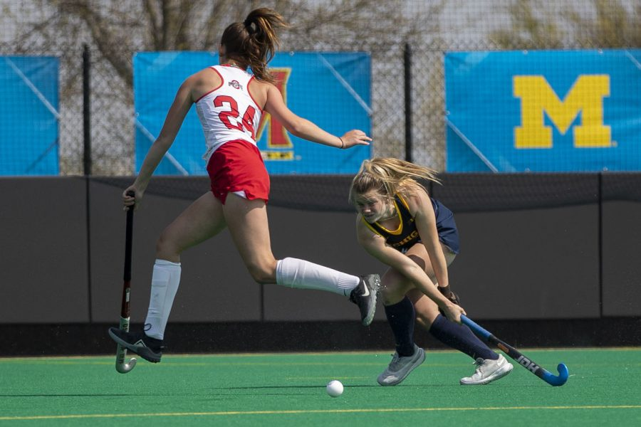 Michigan fullback Rosie Hope sweeps the ball during the first quarter of the Big Ten field hockey tournament championships between No. 1 Michigan and No. 7 Ohio State on Saturday, April 24, 2021 at Grant Field in Iowa City. After defeating No. 5 Iowa in the semifinals on Thursday, Michigan continued on to win the 2021 Big Ten field hockey tournament title. The Wolverines defeated the Buckeyes, 4-0.