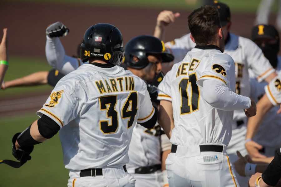 The Hawkeyes celebrate their win during a baseball game in Iowa City between Iowa and Northwestern. The Hawks beat the Wildcats  9-8.