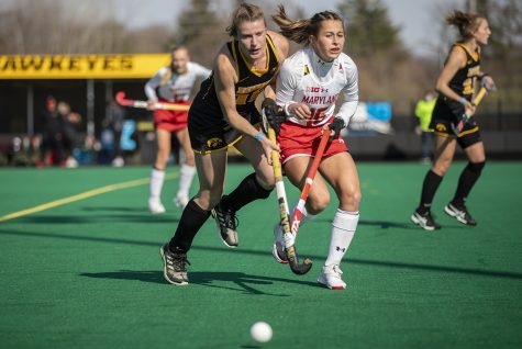 Iowa midfielder Esme Gibson and Maryland midfielder Emma Deberdine run toward the ball during the first quarter of a field hockey game between Iowa and Maryland on Friday, April 2, 2021 at Grant Field. The Hawkeyes were defeated by the Terrapins, 1-0.