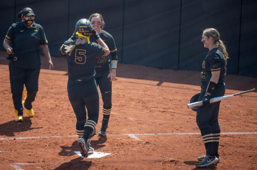 Iowa's Denali Loecker, who plays first base, touches home plate during a softball game at Pearl Field on Saturday, April 3 during a softball game between Iowa and Indiana. Loecker collected two RBIs.The Hawkeyes defeated the Hoosiers 8-0 in five innings.