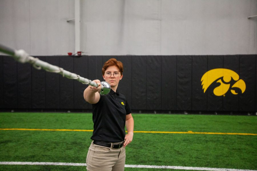 Amanda Thomas, University of Iowa Hawkeye Marching Band Drum Major, poses for a portrait inside the Hawkeye Tennis and Recreation Complex on Wednesday, April 7, 2021.
