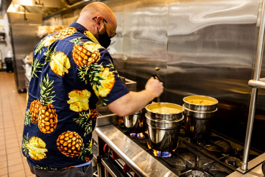 Owner and cook Brandon Ryan checks to make sure the queso is not getting over done. in Tiki Tacos on April, 20, 2021.