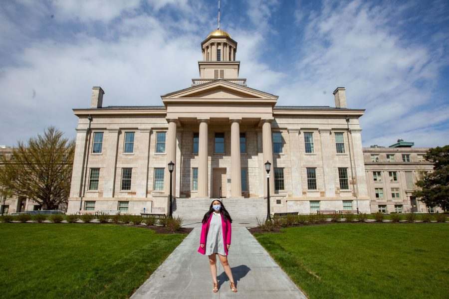 University of Iowa alum, Rebecca Chia, poses for a portrait on the Pentacrest on Sunday, April 25, 2021. Chia graduated with a degree in criminology and sociology, is the creator of the social initiative platform RealizASIANS and is the Princess of America Miss Northern States.