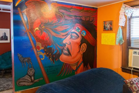 A mural in the Latino Native American Cultural Center is seen at 308 Melrose Ave. in Iowa City, IA. The mural was restored in 2001, but lost its original colors and the original artist