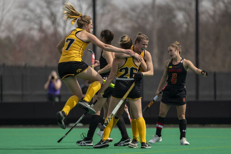 Iowa players celebrate forward Maddy Murphy's score during the fourth quarter of a field hockey game against Maryland on Sunday, April 4, 2021 at Grant Field. The Hawkeyes defeated the Terrapins, 3-0. (Hannah Kinson/The Daily Iowan)