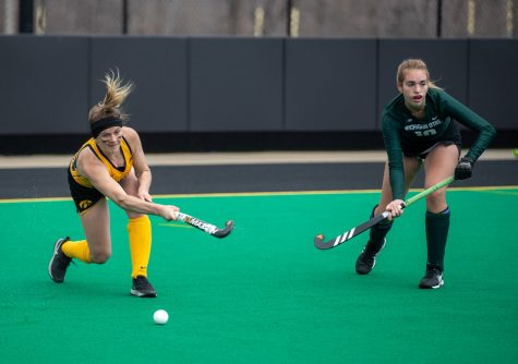 Iowa Forward Maddy Murphy sends the ball upfield during a field hockey game between Iowa and Michigan State at Grant Field on Friday, March 28, 2021. The Hawkeyes defeated the Spartans 2-0.