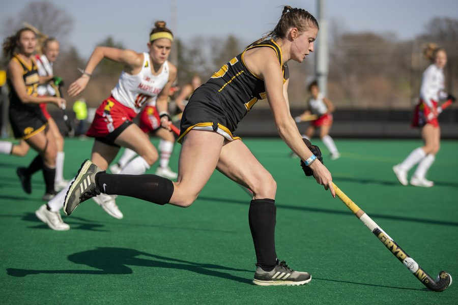 Iowa midfielder Esme Gibson runs down the field with the ball during the second quarter of a field hockey game against Maryland on Friday, April 2, 2021 at Grant Field. The Hawkeyes were defeated by the Terrapins, 1-0. (Hannah Kinson/The Daily Iowan)